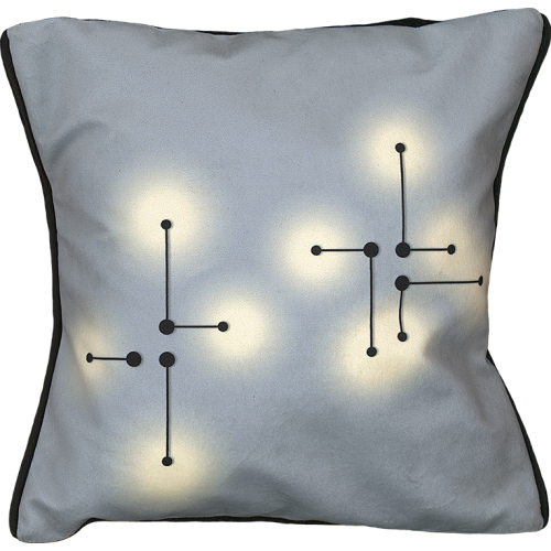 "Cushion cover and its ""Lumières"" pattern"