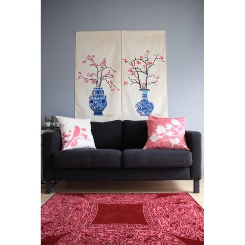 Cushion with a lemon tree pattern